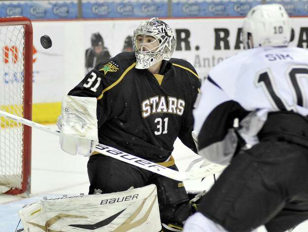 Texas Stars goaltender Richard Bachman, watches the puck sail by as San Antonio Rampage's Jon Sim closes in on the net during the second period of an AHL hockey game, Friday, Jan. 25, 2013, in San Antonio. Photo: Darren Abate, Darren Abate/pressphotointl.com / Darren Abate/pressphotointl.com