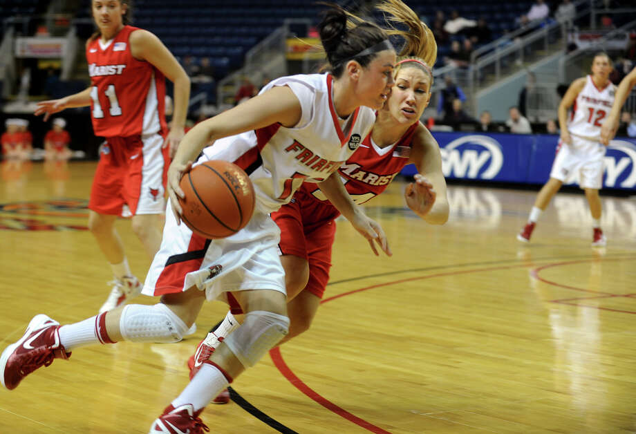 Fairfield University's #13 Alexys Vazquez drives to the basket as Marist's #14 Casey Dulin blocks, during womens basketball action at the Webster Bank Arena in Bridgeport, Conn. on Thursday January 12, 2012. Photo: Christian Abraham / Connecticut Post