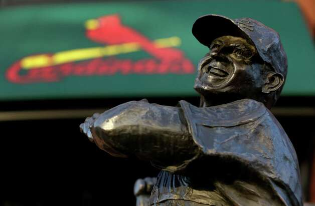 "FILE - In this Jan. 20, 2013 file photo a statue of former St. Louis Cardinals baseball player Stan Musial stands outside Busch Stadium in St. Louis. State and federal lawmakers proposed legislation Wednesday, Jan. 23, 2013 that would name a new bridge the Stan Musial Memorial Bridge — some are already dubbing it the ""Stan Span."" The bridge carrying Interstate 70 traffic is expected to open in 2014.  (AP Photo/Jeff Roberson, File) Photo: Jeff Roberson, Associated Press / AP"