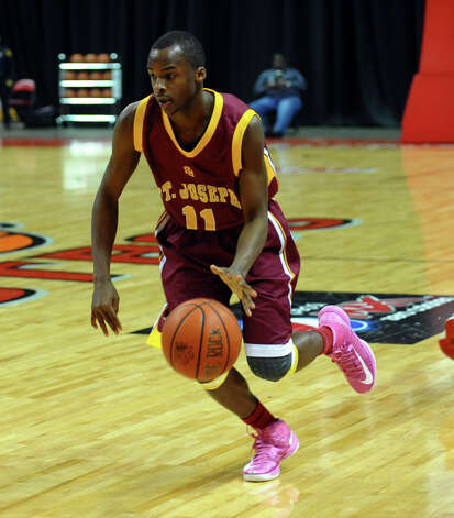 St. Joseph's #11Quincy McKnight drives the ball, during boys basketball action against Bassick at the Webster Bank Arena in Bridgeport, Conn. on Friday January 25, 2013. Photo: Christian Abraham / Connecticut Post