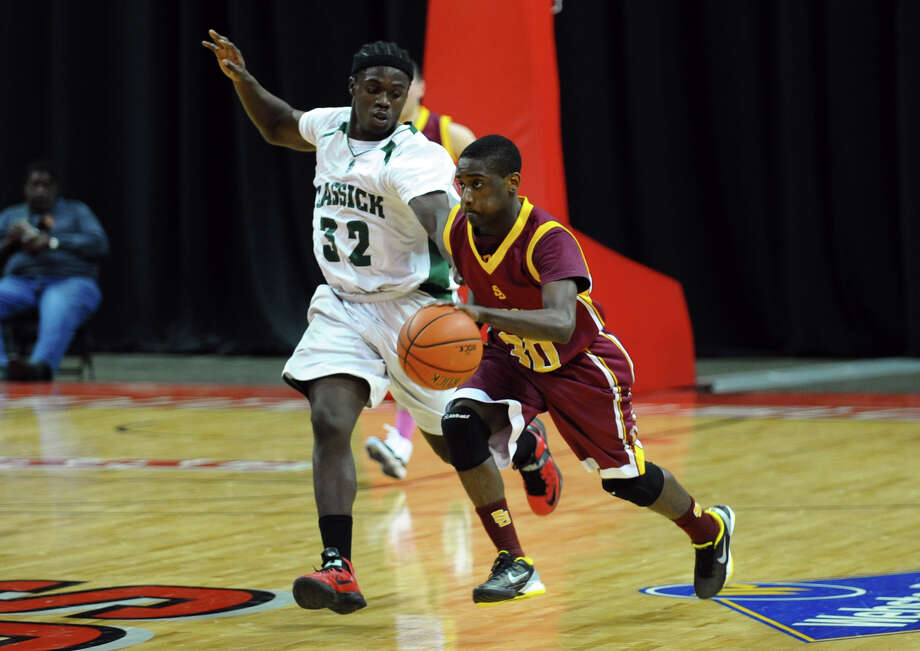 St. Joseph's #30 Reid Raekwon, right, moves past Bassick's #32 Anthony Brown, during boys basketball action at the Webster Bank Arena in Bridgeport, Conn. on Friday January 25, 2013. Photo: Christian Abraham / Connecticut Post