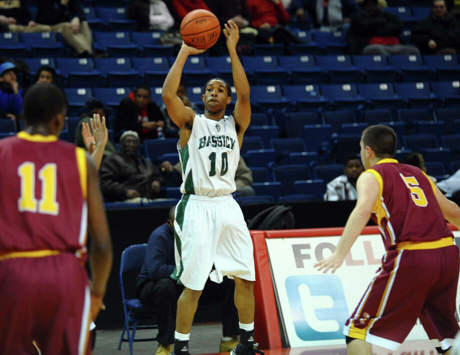 Boys basketball action between Bassick and St. Joseph at the Webster Bank Arena in Bridgeport, Conn. on Friday January 25, 2013. Photo: Christian Abraham / Connecticut Post