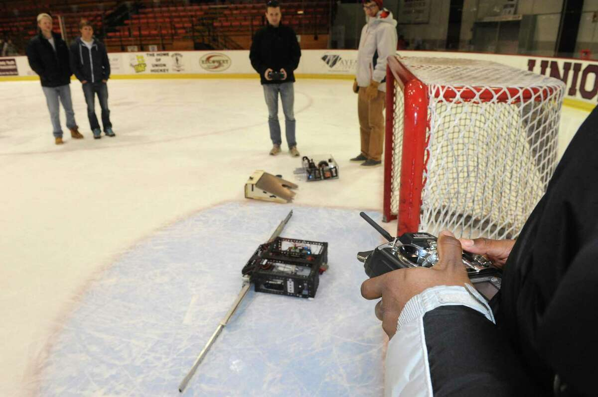 Mechanical engineering student Bessena Cabe, right, controls his offensive hockey robot at Union College on Friday Jan. 25,2013 in Schenectady, N.Y. (Michael P. Farrell/Times Union)