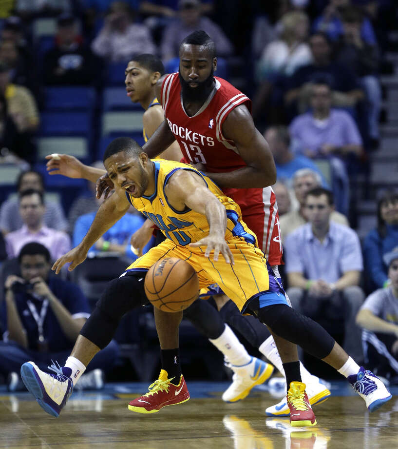 Jan. 25: Rockets 100, Hornets 82Hornets guard Eric Gordon reacts to a foul from Rockets guard James Harden. Photo: Gerald Herbert