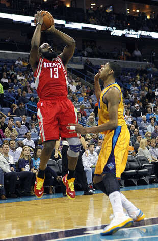 Rockets guard James Harden shoots over Hornets forward Anthony Davis. Photo: Gerald Herbert