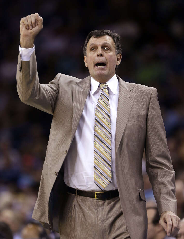 Rockets head coach Kevin McHale gives his team directions in the first half. Photo: Gerald Herbert