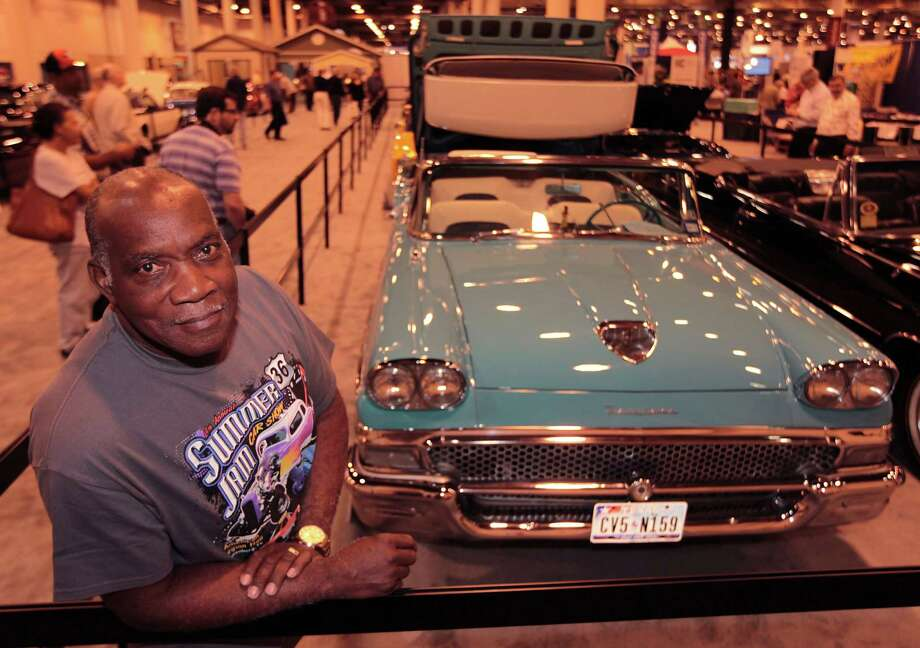 "Cleotha Amos found his 1958 Ford Fairlane Skyliner 22 years ago and rebuilt it. ""I like a car with a lot of  chrome."" Photo: James Nielsen, Staff / © Houston Chronicle 2013"