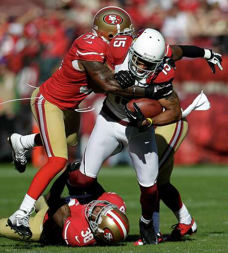 San Francisco safeties Donte Whitner (31) and safety Dashon Goldson (38) were double trouble this season for NFL wide receivers, including Arizona's Michael Floyd (15), who felt their wrath in the regular-season finale. Photo: Marcio Jose Sanchez, STF / AP
