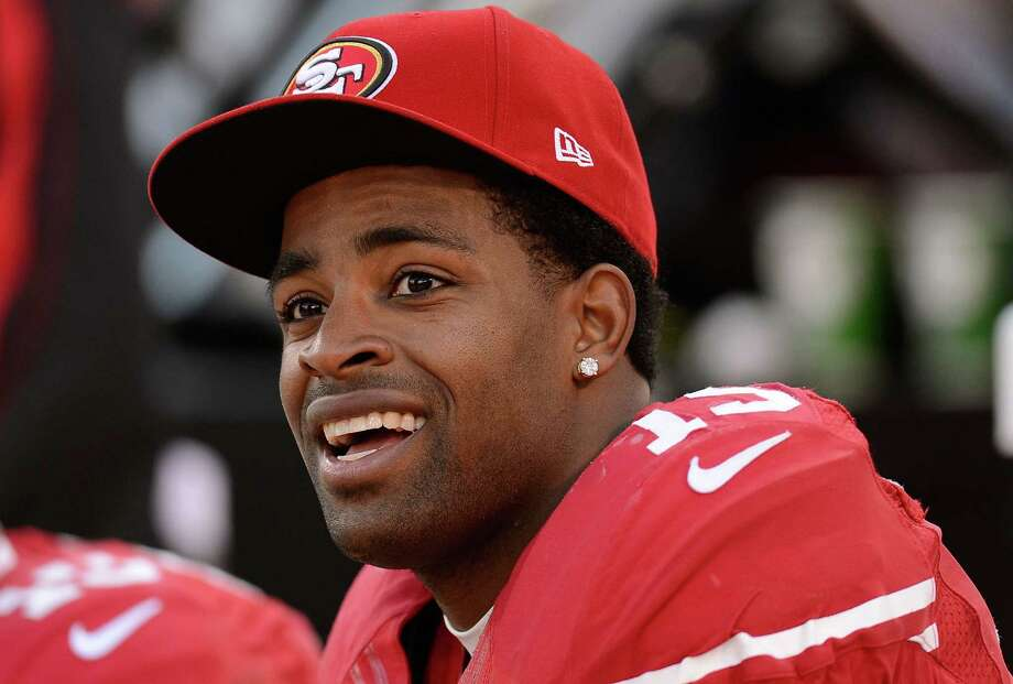 SAN FRANCISCO, CA - DECEMBER 30: Michael Crabtree #15 of the San Francisco 49ers looks on from the sidelines while the 49ers were ahead of the Arizona Cardinals 27-6 late in the fourth quarter at Candlestick Park on December 30, 2012 in San Francisco, California. The 49ers went on to win the game 27-13.  (Photo by Thearon W. Henderson/Getty Images) Photo: Thearon W. Henderson, Stringer / 2012 Getty Images