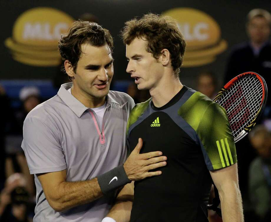 Britain's Andy Murray, right, is congratulated by Switzerland's Roger Federer after Murray won their semifinal match at the Australian Open tennis championship in Melbourne, Australia, Friday, Jan. 25, 2013.(AP Photo/Andy Wong) Photo: Andy Wong