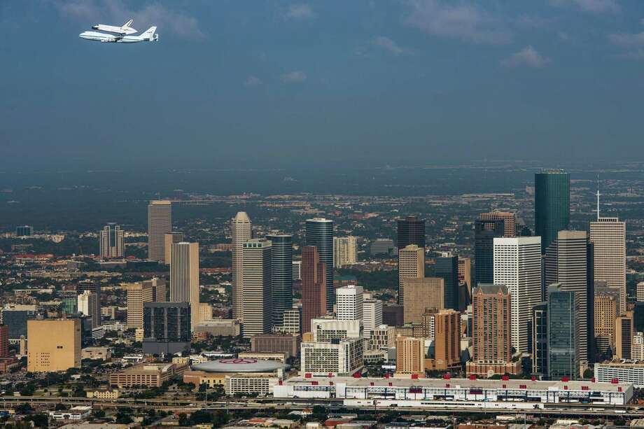 Houston has seen an influx of new companies and talented workers from around the globe who are flocking to the city for highly skilled, high-paying jobs, one corporate recruiter says. Photo: Smiley N. Pool, Staff / © 2012  Houston Chronicle