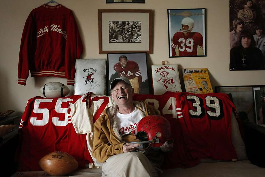 Martin Jacobs, an avid memorabilia collector, with some of his 49ers items on Thursday, January 24, 2013. Jacobs has been collecting 49ers memorabilia since he was a kid watching games at Kezar Stadium. Now, the retired San Francisco resident has what might be the biggest 49ers memorabilia collection in the world and keeps some of it in his San Francisco, Calif., home. Photo: Carlos Avila Gonzalez, The Chronicle