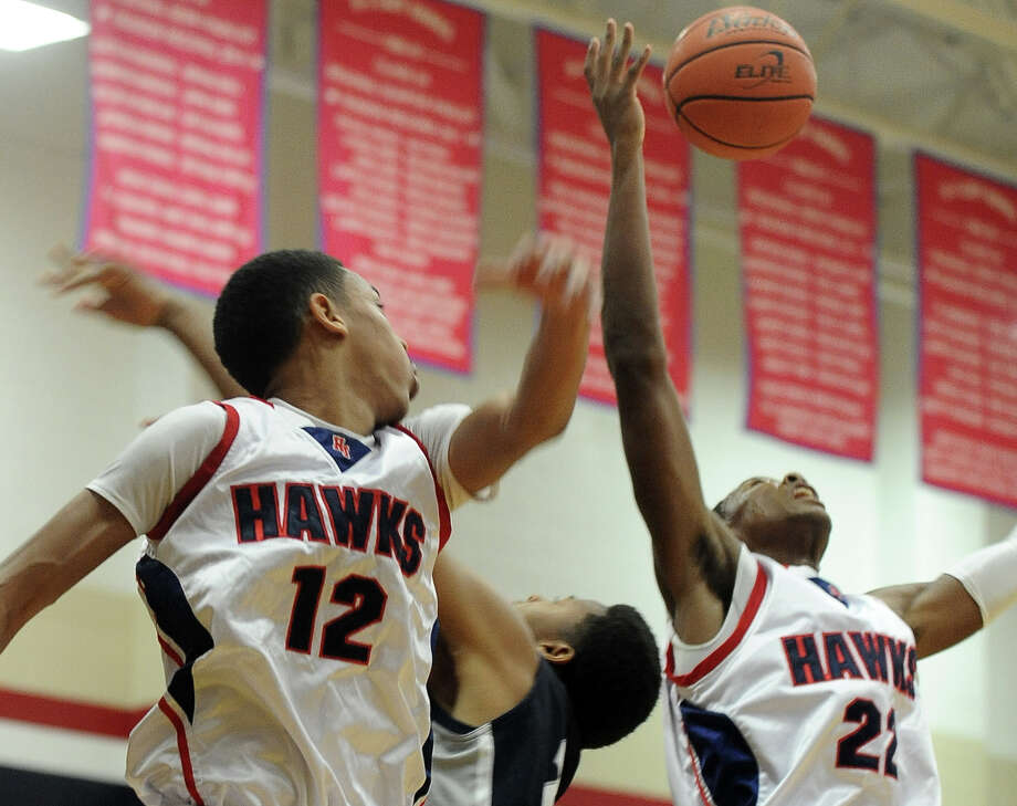 H-J players Dylan Mays, #22, and Travis Stevens, #21, look for the rebound during the Hardin -Jefferson High School boys basketball game against West Orange-Stark High School on Friday, January 25, 2013, at Hardin-Jefferson High School. H-J won over WO-S 47 - 43. Photo taken: Randy Edwards/The Enterprise
