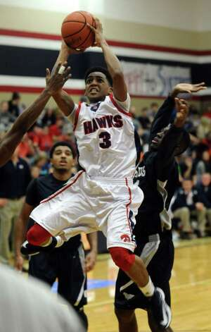 H-J player Devante Johnson, #3, shoots for two during the Hardin -Jefferson High School boys basketball game against West Orange-Stark High School on Friday, January 25, 2013, at Hardin-Jefferson High School. H-J won over WO-S 47 - 43. Photo taken: Randy Edwards/The Enterprise Photo: Randy Edwards