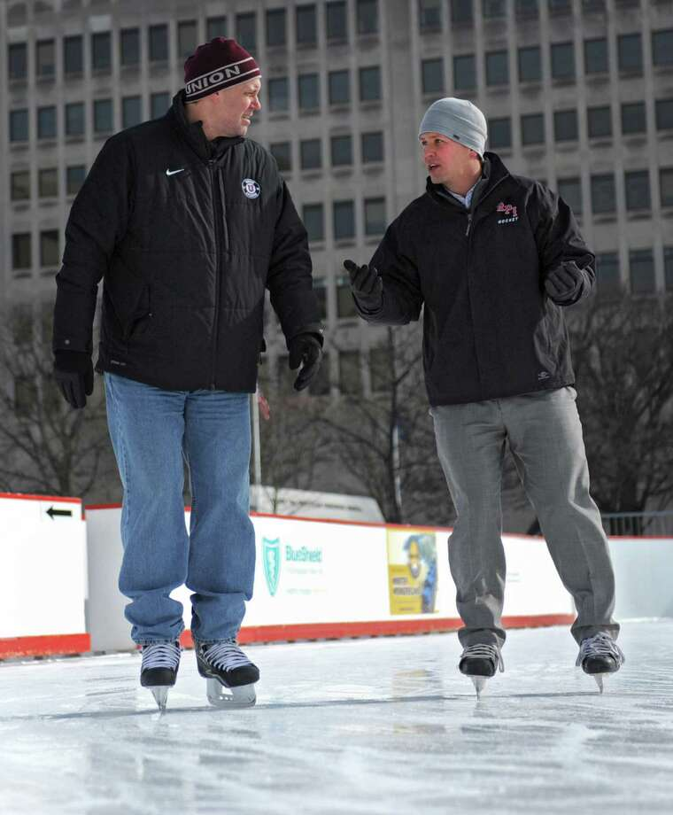 Union hockey coach Rick Bennett, left,  and RPI hockey coach Seth Appert skate at the Empire State Plaza Ice Rink on Friday Jan. 25, 2013 in Albany, N.Y. The two coaches are promoting Saturday's game between the schools at the Times Union Center. Lori Van Buren / Times Union) Photo: Lori Van Buren