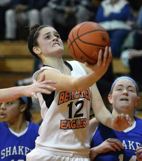 Bethlehem's #12 Jenna Giacone goes for two in Friday's game against Shaker at Bethlehem High Jan. 25