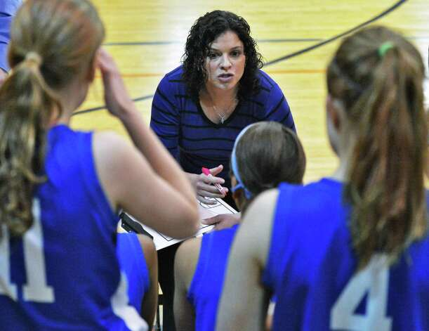 Shaker head coach Emily Casehera-Blowers with players during Friday's game against  Bethlehem High Jan. 25, 2013.  (John Carl D'Annibale / Times Union) Photo: John Carl D'Annibale / 10020885A