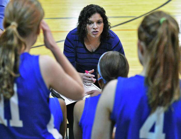 Shaker head coach Emily Casehera-Blowers with players during Friday's game against  Bethlehem High J