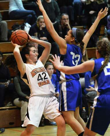 Bethlehem's #42 Kylie MvKenna, left, tries to pass against Shaker double teaming in Friday's game at Bethlehem High Jan. 25, 2013.  (John Carl D'Annibale / Times Union) Photo: John Carl D'Annibale / 10020885A