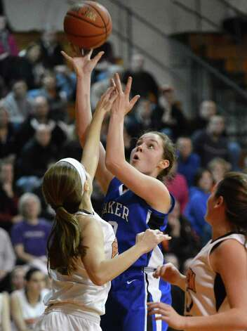 Shaker's #20 Sage VanAmerongen, center, goes to the basket against Bethlehem at Bethlehem High Friday Jan. 25, 2013.  (John Carl D'Annibale / Times Union) Photo: John Carl D'Annibale / 10020885A