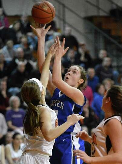 Shaker's #20 Sage VanAmerongen, center, goes to the basket against Bethlehem at Bethlehem High Frida