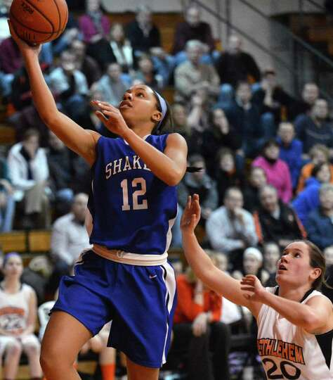 Shaker's #12 Madison Rowland, left, gets by Bethlehem's #20 Bridget Murphy for two points in Friday'