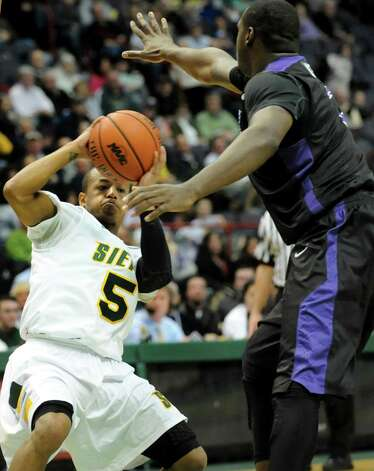 Siena's Evan Hymes (5), left, looks to pass as Niagara's Devon White (2) defends during their basketball game on Friday, Jan. 25, 2013, at Times Union Center in Albany, N.Y. (Cindy Schultz / Times Union) Photo: Cindy Schultz / 00020763A