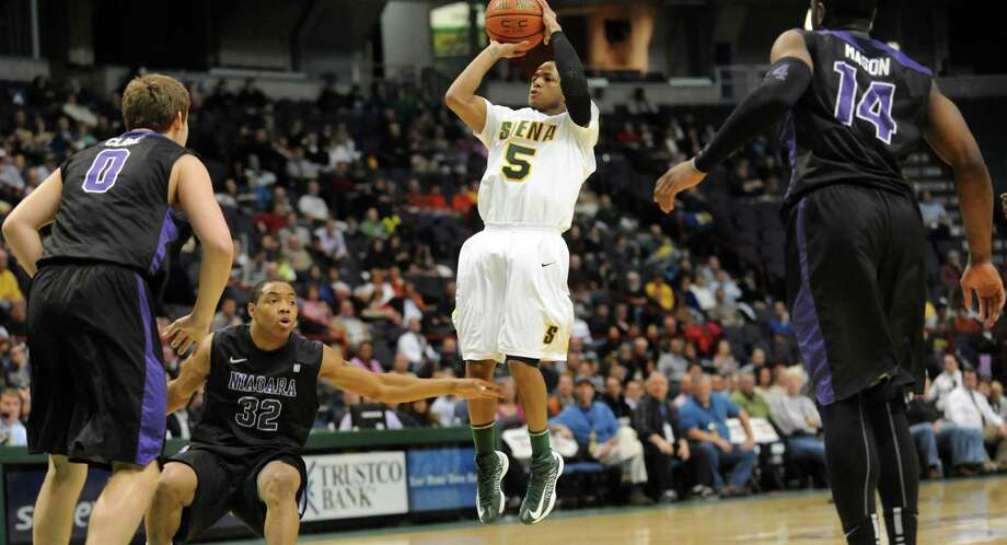 Siena's Evan Hymes (5), center, shoots for 3-points during their basketball game against Niagara on Friday, Jan. 25, 2013, at Times Union Center in Albany, N.Y. (Cindy Schultz / Times Union) Photo: Cindy Schultz / 00020763A