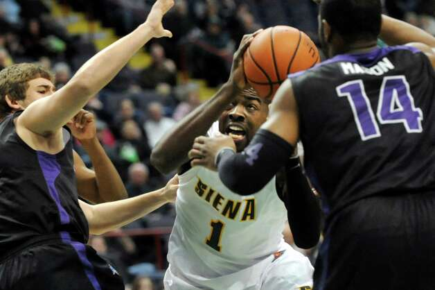 Siena's O.D. Anosike (1) looks to pass during their basketball game against Niagara on Friday, Jan. 25, 2013, at Times Union Center in Albany, N.Y. (Cindy Schultz / Times Union) Photo: Cindy Schultz / 00020763A