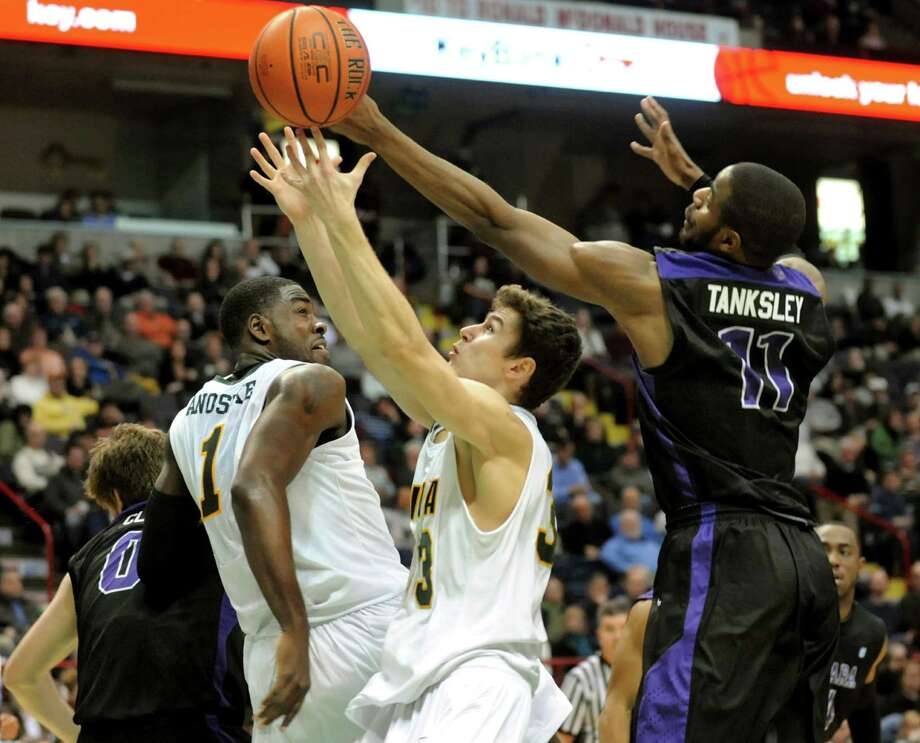 Siena's Rob Poole (33), center, fights for a rebound against  Niagara's Ameen Tanksley (11) during their basketball game on Friday, Jan. 25, 2013, at Times Union Center in Albany, N.Y. At left is O.D. Anosike (1). (Cindy Schultz / Times Union) Photo: Cindy Schultz / 00020763A