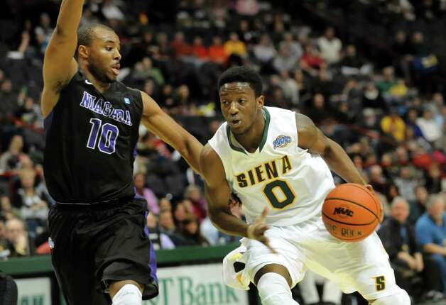 Siena's Rich Audu (0), right, drives past Niagara's Juan'ya Green (10) during their basketball game on Friday, Jan. 25, 2013, at Times Union Center in Albany, N.Y. (Cindy Schultz / Times Union) Photo: Cindy Schultz / 00020763A