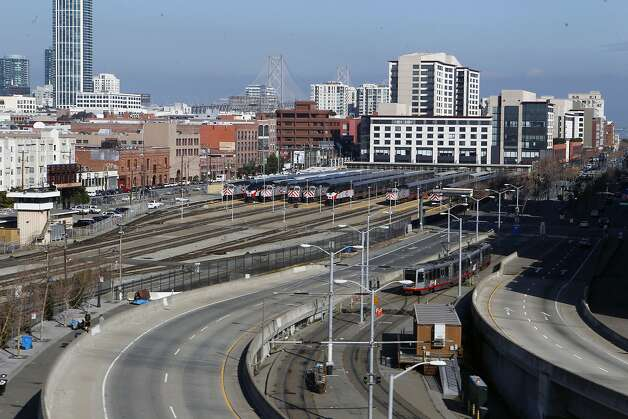 The city hopes to shrink, eliminate or relocate the Caltrain rail yard - seen here from I-280 - to foster the blossoming of the formerly gritty Mission Bay neighborhood. Photo: Jessica Olthof, The Chronicle