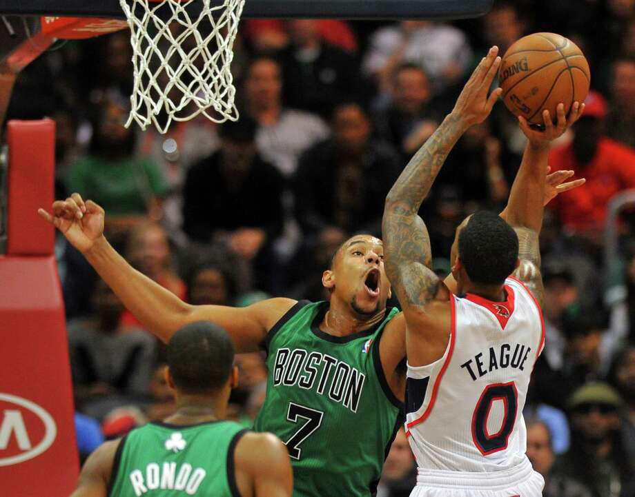 Atlanta's Jeff Teague (0) shoots over Boston's Jared Sullinger during the Hawks' second-half comeback on their way to a double-overtime win Friday night. Photo: BRANT SANDERLIN, MBR / Atlanta Journal-Constitution