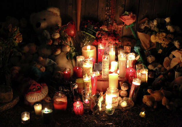 Candles burn at a memorial for Brandon Abrams, during a vigil attended by over 100 mourners on the Northwest Side of the city on Friday, Jan. 25, 2013. Photo: Kin Man Hui, San Antonio Express-News / © 2012 San Antonio Express-News