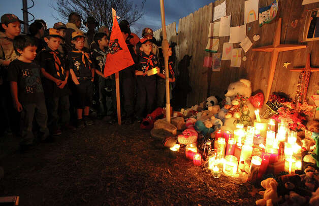 Members of Cub Scout Pack 352 light candles in memory of their fallen friend Brandon Abrams. The Cub Scouts were at the vigil attended by more than 100 people mourning the boy who died after big hit by a car on Autumn Sunrise. Photo: Kin Man Hui, San Antonio Express-News / © 2012 San Antonio Express-News