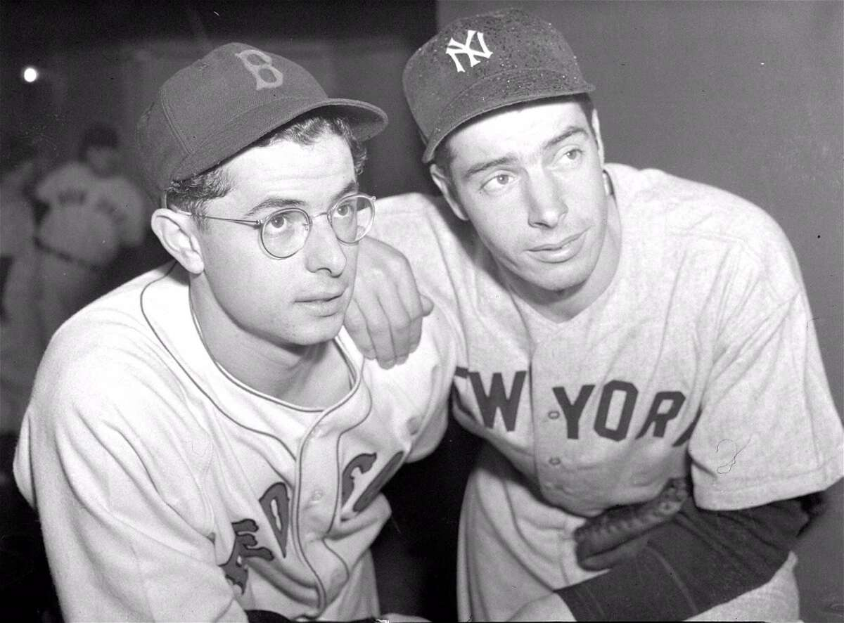 Dom, left, and Joe DiMaggio never met in the postseason, but in an epic 1949 series for the AL pennant, Joe's Yankees took two from Dom's Red Sox to earn a trip to the World Series. The pennant chase was chronicled in the David Halberstam book 'Summer of '49.'Upper hand: Older brother.