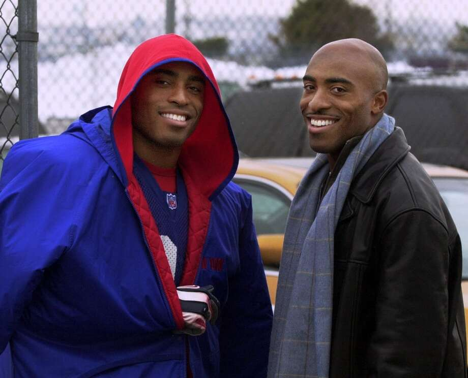 Twins Tiki, left, and Ronde Barber split their four on-field matchups. They've written eight children's books together with titles like 'Kickoff!' and 'By My Brother's Side.'Upper hand: Neither. Photo: BILL KOSTROUN, Associated Press / AP