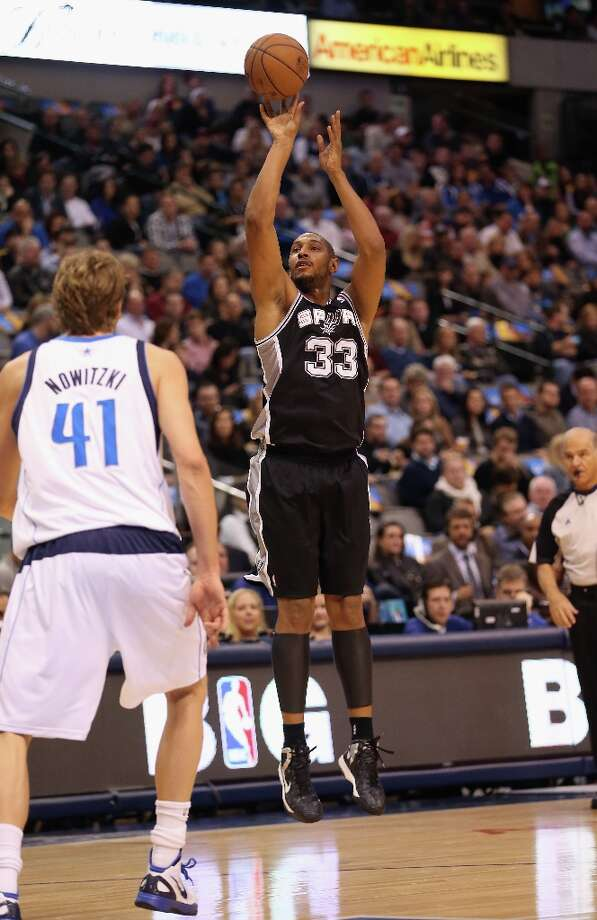 DALLAS, TX - JANUARY 25:  Boris Diaw #33 of the San Antonio Spurs takes a shot against Dirk Nowitzki #41 of the Dallas Mavericks at American Airlines Center on January 25, 2013 in Dallas, Texas.  NOTE TO USER: User expressly acknowledges and agrees that, by downloading and or using this photograph, User is consenting to the terms and conditions of the Getty Images License Agreement. Photo: Ronald Martinez, Getty Images / 2013 Getty Images