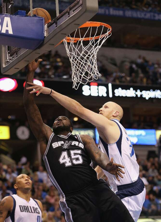 DALLAS, TX - JANUARY 25:  DeJuan Blair #45 of the San Antonio Spurs takes a shot against Chris Kaman #35 of the Dallas Mavericks at American Airlines Center on January 25, 2013 in Dallas, Texas.  NOTE TO USER: User expressly acknowledges and agrees that, by downloading and or using this photograph, User is consenting to the terms and conditions of the Getty Images License Agreement. Photo: Ronald Martinez, Getty Images / 2013 Getty Images