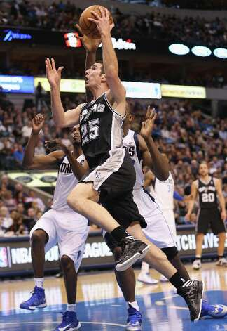 DALLAS, TX - JANUARY 25:  Nando de Colo #25 of the San Antonio Spurs takes a shot against the Dallas Mavericks at American Airlines Center on January 25, 2013 in Dallas, Texas.  NOTE TO USER: User expressly acknowledges and agrees that, by downloading and or using this photograph, User is consenting to the terms and conditions of the Getty Images License Agreement. Photo: Ronald Martinez, Getty Images / 2013 Getty Images