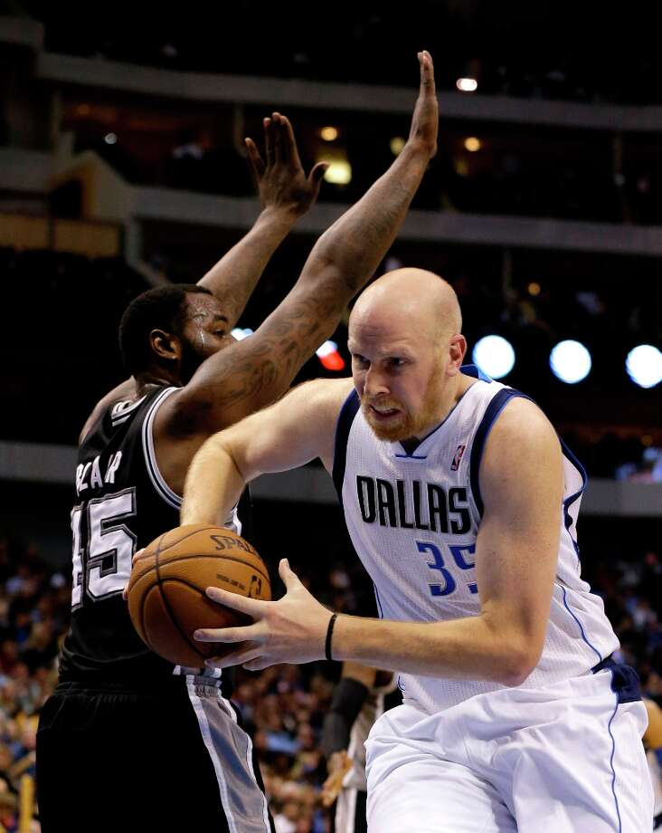 Dallas Mavericks' Chris Kaman (35) gets by San Antonio Spurs' DeJuan Blair (45) on a drive to the basket in the first half of an NBA basketball game on Friday, Jan. 25, 2013, in Dallas. (AP Photo/Tony Gutierrez) Photo: Tony Gutierrez, Associated Press / AP