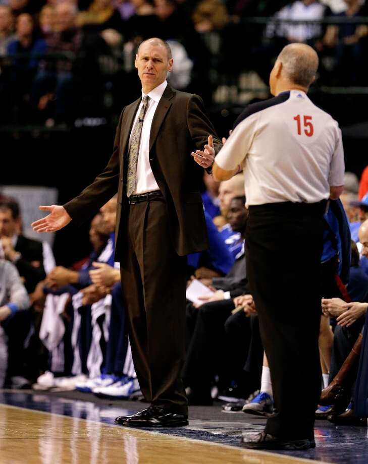 Rick Carlisle reacts as he talks to referee Bennett Salvatore (15) in the first half of an NBA basketball game against the San Antonio Spurs  Friday, Jan. 25, 2013, in Dallas. (AP Photo/Tony Gutierrez) Photo: Tony Gutierrez, Associated Press / AP