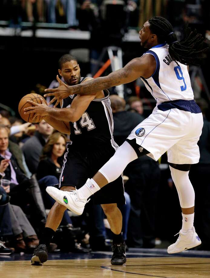 San Antonio Spurs' Gary Neal (14) attempts to pass the ball as Dallas Mavericks' Jae Crowder (9) defends in the first half of an NBA basketball game Friday, Jan. 25, 2013, in Dallas. (AP Photo/Tony Gutierrez) Photo: Tony Gutierrez, Associated Press / AP