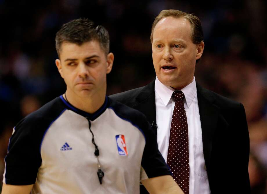 Referee Eli Roe, left, walks away as San Antonio Spurs acting coach Mike Budenholzer, right, complains about a play against the Dallas Mavericks in the first half of an NBA basketball game on Friday, Jan. 25, 2013, in Dallas. Spurs head coach Greg Popovich was absent from the game.  (AP Photo/Tony Gutierrez) Photo: Tony Gutierrez, Associated Press / AP