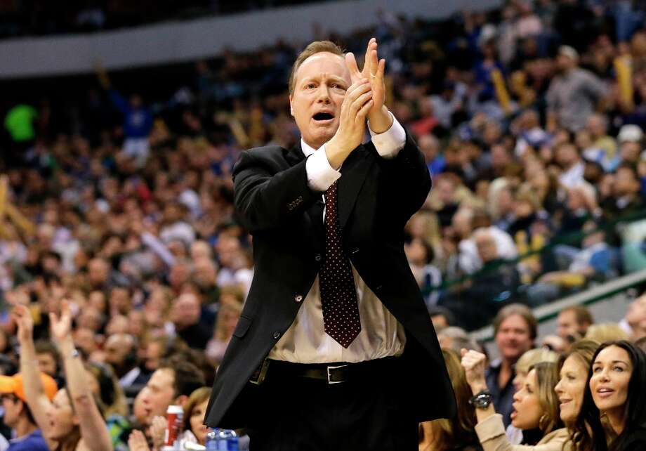 San Antonio Spurs coach Mike Budenholzer calls for a time out in the first half of an NBA basketball game against the Dallas Mavericks  Friday, Jan. 25, 2013, in Dallas. (AP Photo/Tony Gutierrez) Photo: Tony Gutierrez, Associated Press / AP