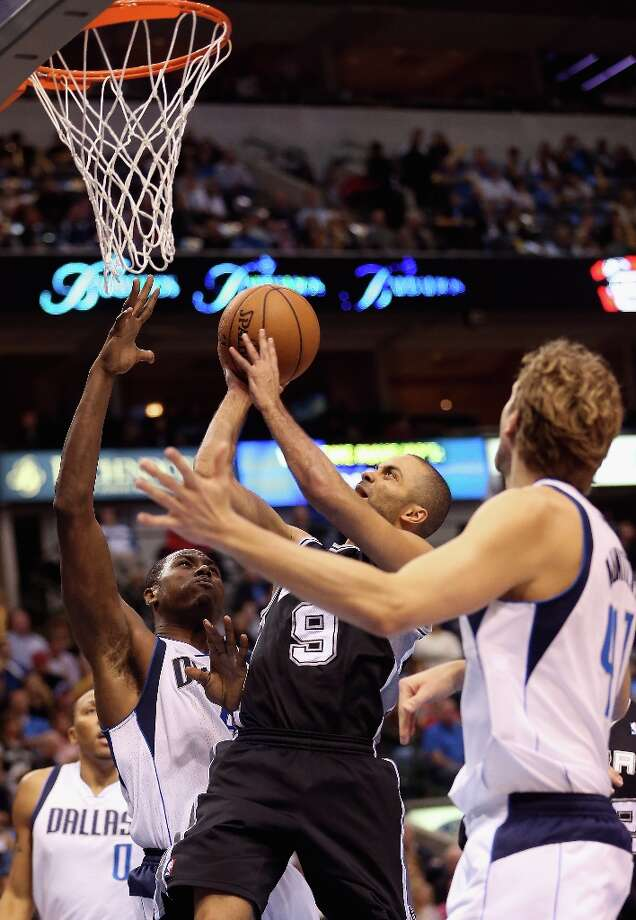DALLAS, TX - JANUARY 25:  Tony Parker #9 of the San Antonio Spurs takes a shot against Elton Brand #42 of the Dallas Mavericks at American Airlines Center on January 25, 2013 in Dallas, Texas.  NOTE TO USER: User expressly acknowledges and agrees that, by downloading and or using this photograph, User is consenting to the terms and conditions of the Getty Images License Agreement. Photo: Ronald Martinez, Getty Images / 2013 Getty Images