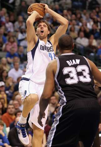 DALLAS, TX - JANUARY 25:  Dirk Nowitzki #41 of the Dallas Mavericks takes a shot against Boris Diaw #33 of the San Antonio Spurs at American Airlines Center on January 25, 2013 in Dallas, Texas.  NOTE TO USER: User expressly acknowledges and agrees that, by downloading and or using this photograph, User is consenting to the terms and conditions of the Getty Images License Agreement. Photo: Ronald Martinez, Getty Images / 2013 Getty Images