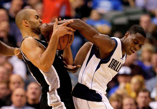 San Antonio Spurs' Tony Parker, left, of France, attempts to steal the ball away from Dallas Mavericks' Darren Collison, right, in the second half of an NBA basketball game on Friday, Jan. 25, 2013, in Dallas. Collison was able to retain control of the ball in the 113-107 Mavericks loss. (AP Photo/Tony Gutierrez) Photo: Tony Gutierrez, Associated Press / AP