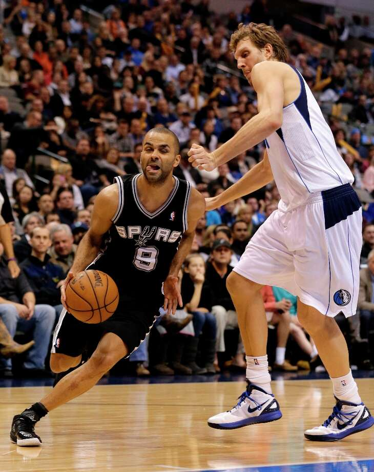 San Antonio Spurs' Tony Parker (9) of France drives past Dallas Mavericks' Dirk Nowitzki of Germany in the second half of an NBA basketball game Friday, Jan. 25, 2013, in Dallas. The Spurs won 113-107. (AP Photo/Tony Gutierrez) Photo: Tony Gutierrez, Associated Press / AP