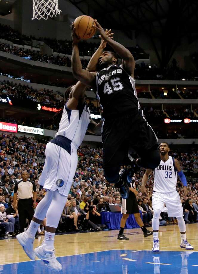 Dallas Mavericks' Jae Crowder, left, fouls San Antonio Spurs' DeJuan Blair (45) on a shot-attempt in the second half of an NBA basketball game on Friday, Jan. 25, 2013, in Dallas. Blair had 22-points in the 113-107 Spurs win. (AP Photo/Tony Gutierrez) Photo: Tony Gutierrez, Associated Press / AP